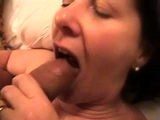 Busty brunette amateur gives sexy blowjob in bedroom