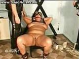 Chubby slave gets her pussy spread with clamps and spanked