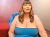 Divine mature lady with giant tits shows her fat ass_