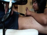 Indian housewife kneels in front of her white husband to