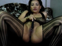 Beautiful Asian mommy fingers her love tunnel