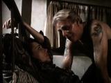 Tied slave slut being used in a vintage fetish vid