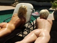 Enema babe squirting by the pool with lesbian