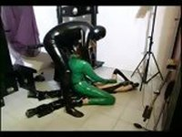 Two slave girls pleasing their master