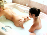 Bathing lesbos squirt milk from their bootys