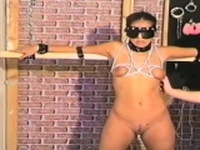 Dark haired slave gets tied and tortured by stud