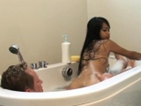 Soapy asian masseuse baths before tugging