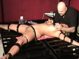 Aroused honey is playing with love beads