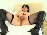 English milf Karina looks hot in leggings and long boots