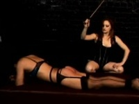 Mistress Gemini goes all out on her slave whipping her on the ass