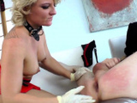 Strapon clad domina jerking losers cock