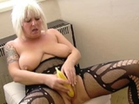 Mesmerizing MILF in stockings uses a banana