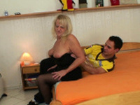 Hairy-pussy granny in stockings rides strangers cock