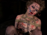 Fastened up hotty receives tongue and facial punishment