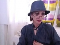 Slim Granny Does A Striptease