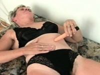 Horny granny pleases herself