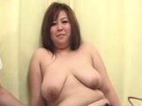 Busty Japanese tart fingering cunt sucking cock