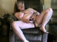 Solo mature in an amazing striptease masturbation show