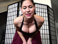 Busty brunette undresses pink lingerie and caresses ass