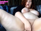 Fat redhead plays with pussy until she squirting