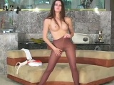Breasty minx shows pleasing feet and bald slit in hose