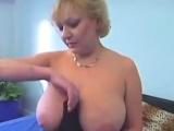 Busty blonde mature hoe in stockings finger fucks herself