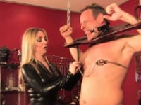 British domme clamping her bound subject