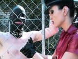 Latex mistress wanks outdoors caged sub