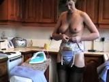 Sara irons while topless
