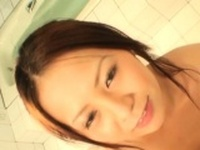 Hot young oriental plays with knob and gets a creamy reward