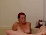 Hot redhead water jet orgasm