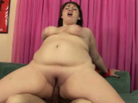 Large and busty brunette babe sucks dick