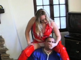 Female domination scenery with busty hottie smothering a lad
