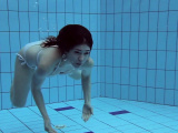 Roxalana submerged in the pool naked