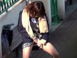 Asian teens in uniform pee outdoors