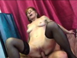 Busty brunette granny riding long shaft on couch