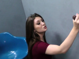 Teen sucking at gloryhole