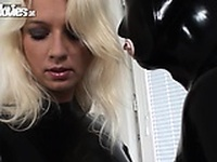 Masked girl in latex sucking blonde hoties strapon