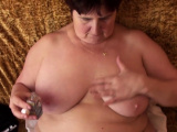 Fatty strips off her clothes for the camera