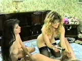 Girls share a cock and play with their strap-on