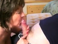Grandma giving a sensual and slowly blowjob to her lover
