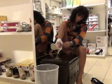 Horny woman in a shoe store cant wait to flash her ass and